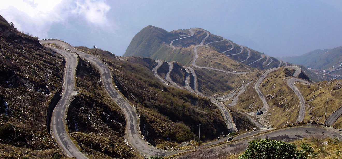 Thrilling bike ride in 31 hairpin bend road of Zuluk