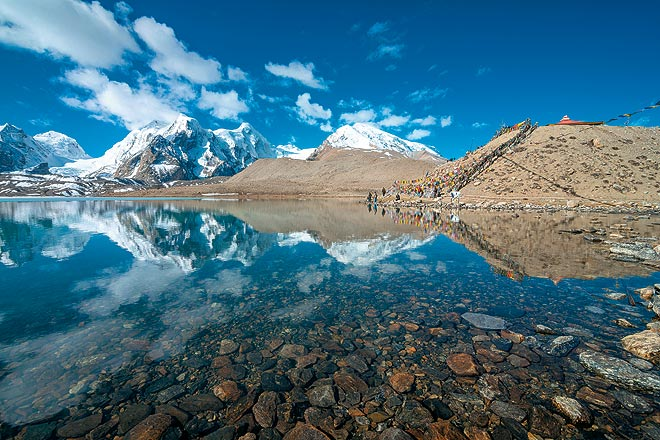 Visit the mystical Gurudongmar Lake by hiring a rental car in Sikkim