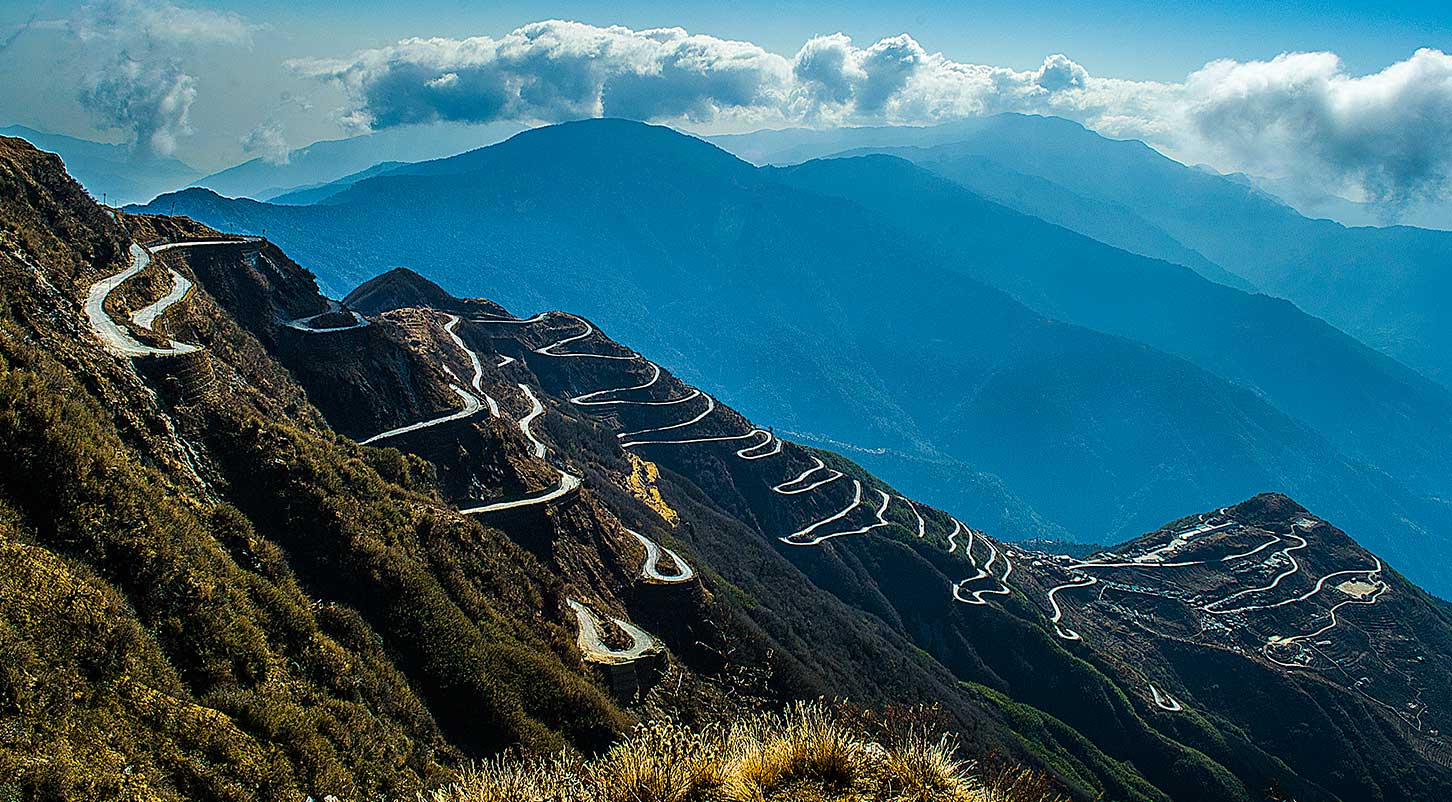 Easily hire a rental car in Sikkim with North Bengal Tourism to enjoy the pictorial road of Zuluk