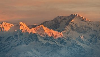 Sunrise over the Kanchenjunga peak from Tiger Hill. This is one of the most stunning places to visit in Darjeeling.