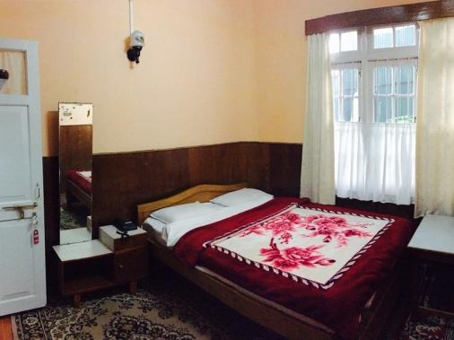 Book Non-AC Deluxe Room Three Bed Room at Deki Lodge, Darjeeling