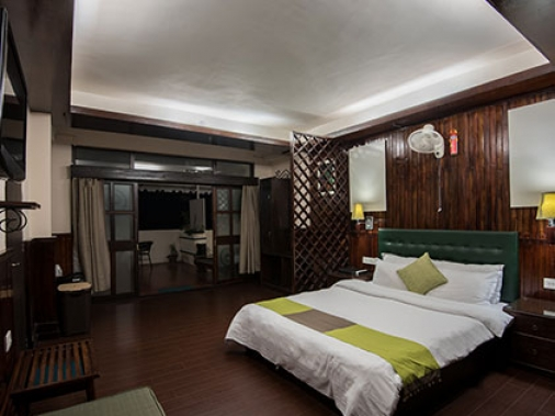 Book Non-AC Valley View Super Deluxe Family Suite Room (Double)  at The Nettle and Fern Hotel, Sikkim